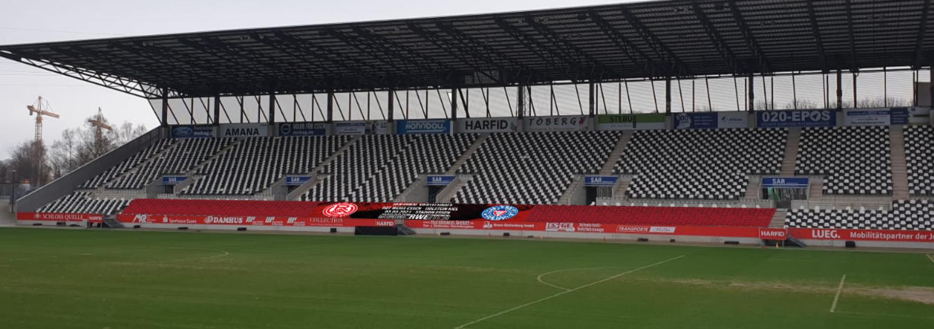 Seid dabei: Mit eurem Bild auf dem Mega-Banner der Rahn-Tribüne zum DFB-Pokal Viertelfinale gegen Holstein Kiel. (Foto: RWE)